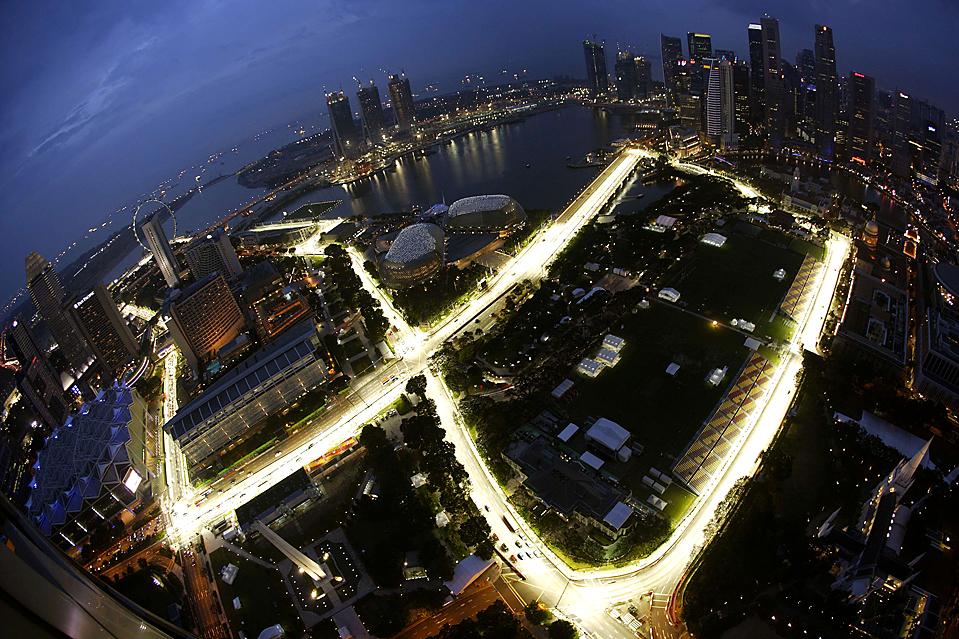 The Marina Bay street circuit of the Singapore F1 Grand Prix is seen illuminated at dusk
